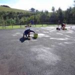 Patch Reparing An Old Tennis Court