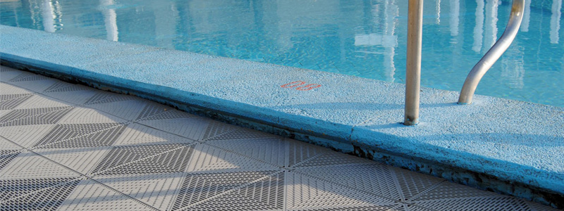 Wet area swimming pool flooring outdoor pool surrounds for Best flooring for house with pool